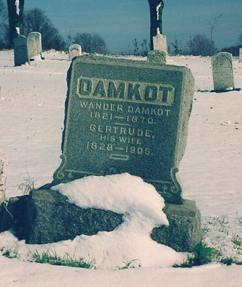 Gravestone with text: Wander Damkot 1821-1870. Gertrude his wife 1828-1905.