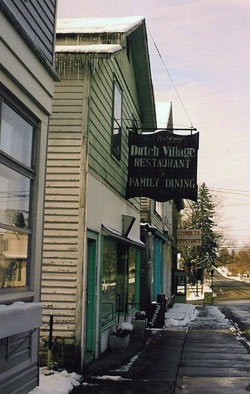 Photograph of restaurant with sign: Dutch village restaurant - family dining