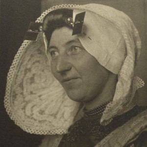 Woman wearning a traditional hat with ear irons