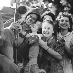 Allied soldier hugged by girls.