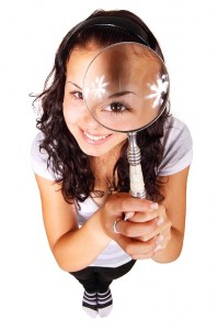 woman holding a looking glass