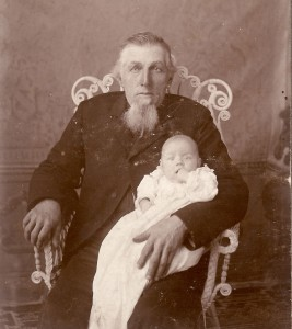 Old man holding a baby