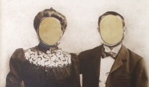 Old photograph with the faces cut out