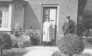 Henk's parents in front of their house.