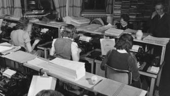 women in a type room