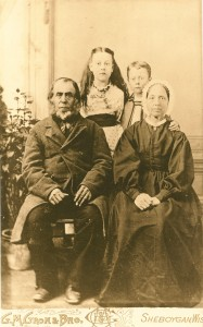 Family portrait of a family with two children.