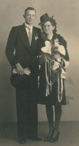 Young couple, the woman holds a bouquet of arums in her hand
