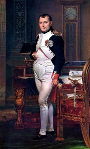 Portrait of Napoleon standing beside his desk