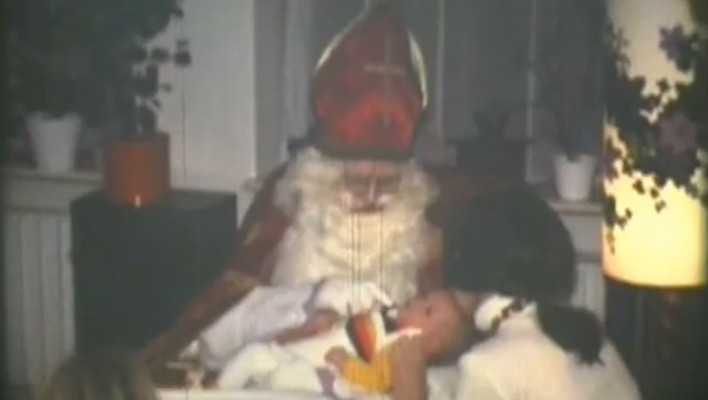 Baby in the lap of Saint Nicholas