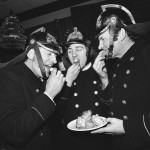 Firemen eating 'oliebollen'