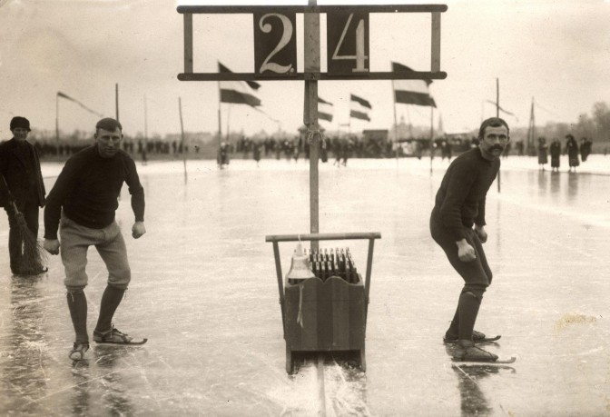 Two men on skates near a start line