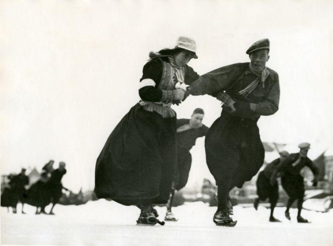 Man and woman in costume skating