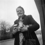 Woman carrying food distributed by allied forces, World War II