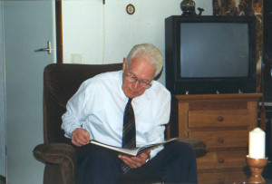 Henk going over the family book