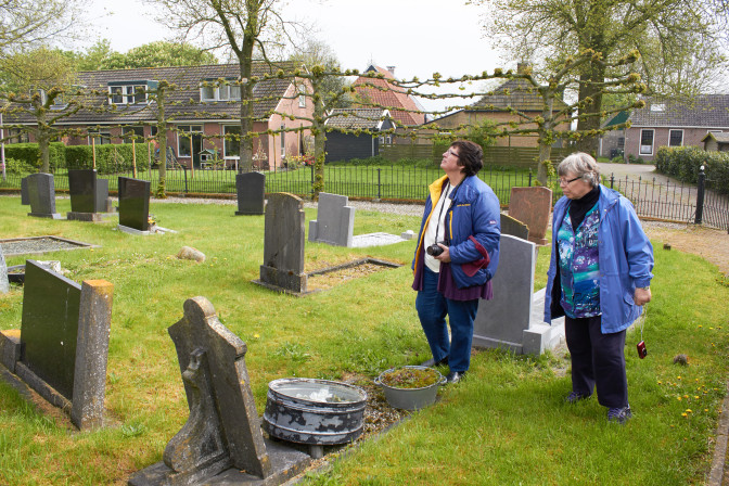 Roberta (left) and Cheryl locating the graves of their distant cousins at the Baard Cemetery