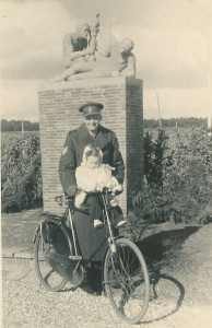 Soldier and child on a bike