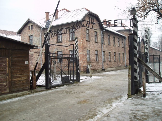 Auschwitz main gate with the text 'Arbeit macht frei'