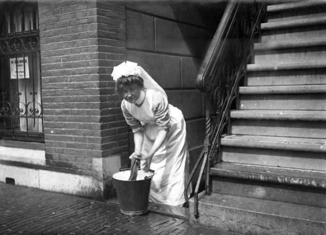maid scrubbing the pavement