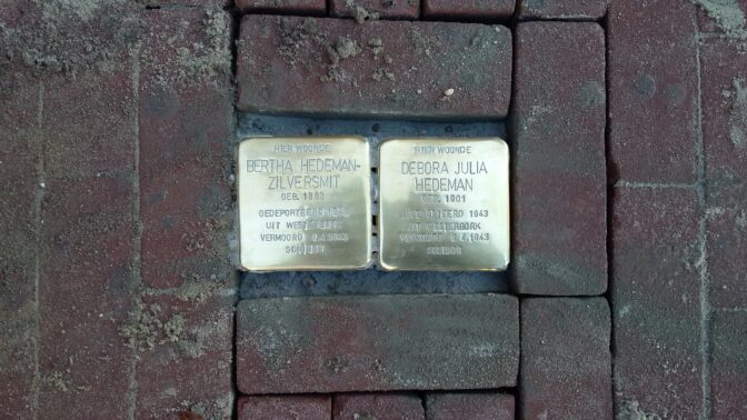 two bronze monuments in the pavement