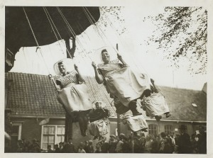 Dutch women in traditional costume in a carousel