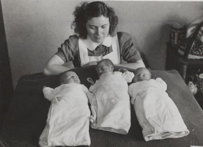 Nurse with three babies