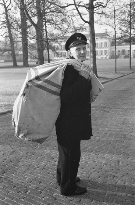 Mail man carrying a full mail bag