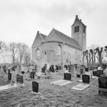 Church surrounded by graves