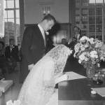 bride signs the marriage record