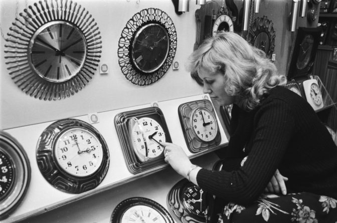 women setting time on a clock
