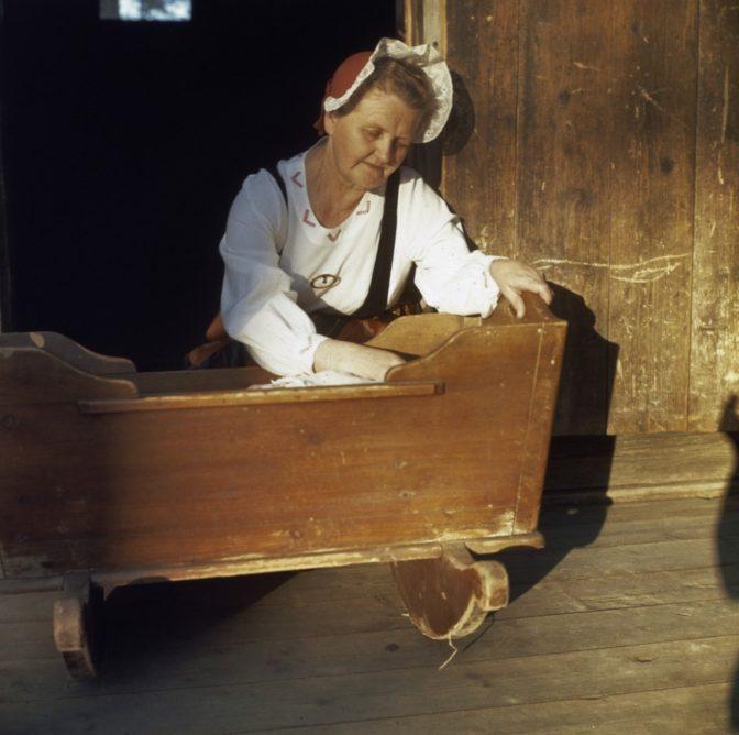 Woman next to a crib