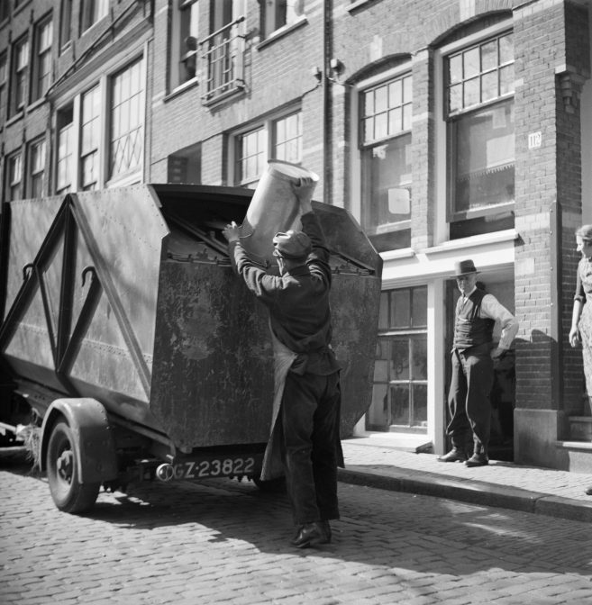 Garbage man emptying a bin in a garbage truck