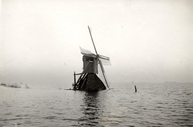 windmill surrounded by water