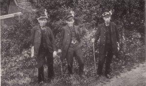 three dressed up men