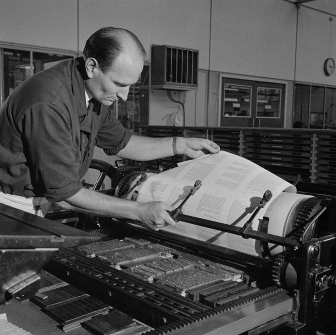 man operating a printing press