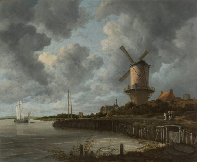 windmill next to a river