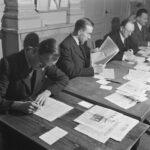 men behind desks
