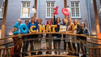 group photo of archivists holding balloons to celebrate 10 years of chat