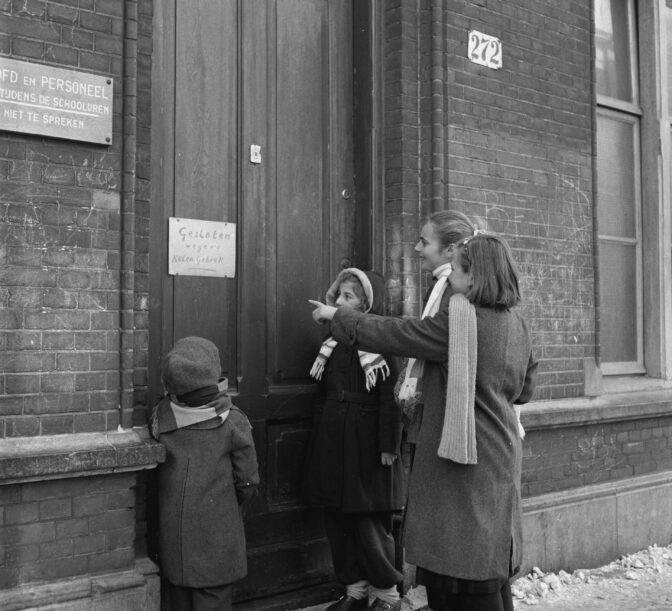 Children in front of a closed door