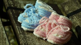 pink and blue baby shoes