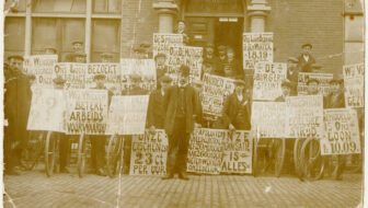 photo of men with signs protesting low wages